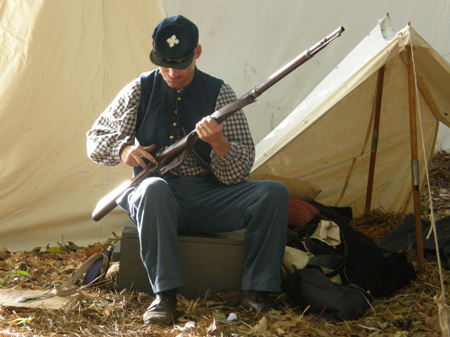 Rebel soldier loads his weapon for battle at Fort Branch