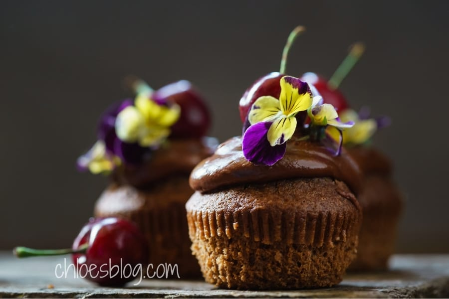 Cupcake with edible pansy photo from Innkeeper at Big Mill BB